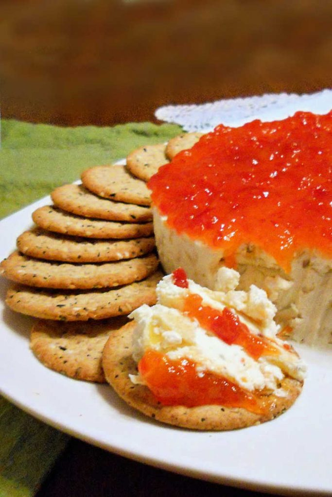 The goat cheese cheesecake with pickled peppers and pepper jelly along with crackers.