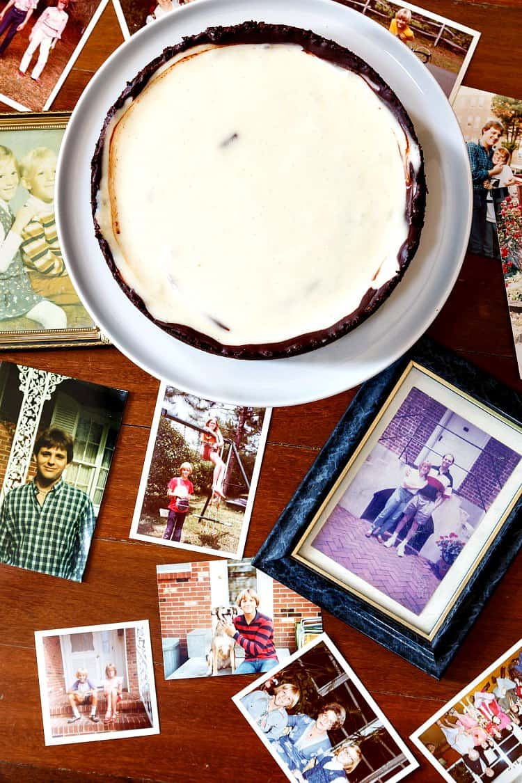 A collage of photographs of my brother and me, taken from overhead, with the uncut chocolate cheesecake pie towards the top of the frame.