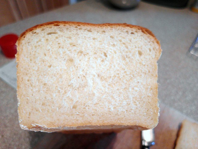 A cross section of a loaf of soft white bread.