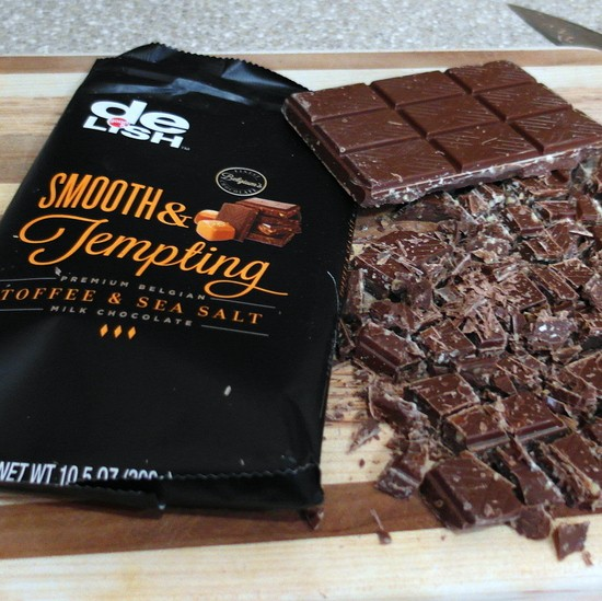 """A bar of Delish """"smooth and tempting"""" toffee and sea salt chocolate chopped up ready to make Brown Butter Toffee Chocolate Chip Cookies."""