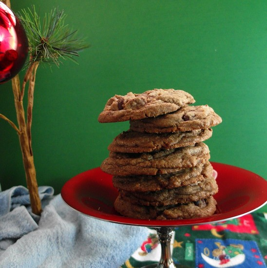 Stacked Brown Butter Toffee Chocolate Chip Cookies on a holiday table.
