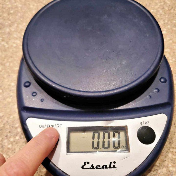 A closeup shot of a dark blue digital scale.