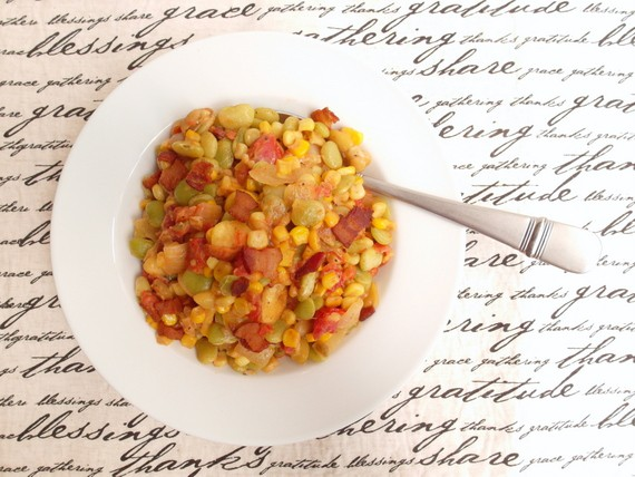 Overhead shot of a white plate of succotash on a graphic placemat.