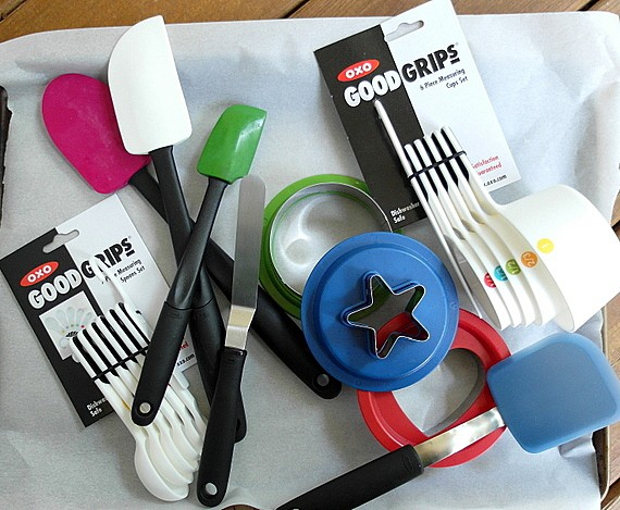 OXO gadgets including 3 spatulas, a small offset spatula, measuring spoons, cookie cutters, and measuring cups.