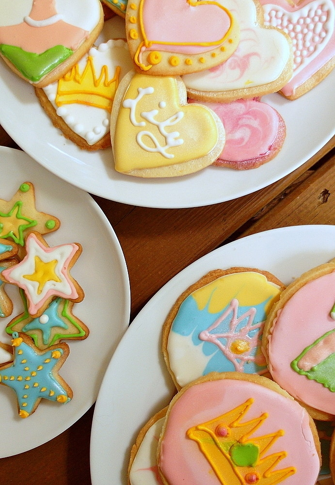 Gourmet decorated shortbread cookies (princess-theme) on plates.