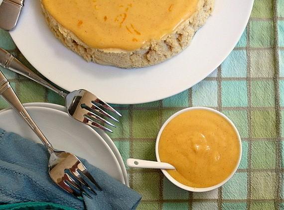 Whole pumpkin butter Japanese cheesecake and ramekin of Pumpkin Spice Tangerine Curd.