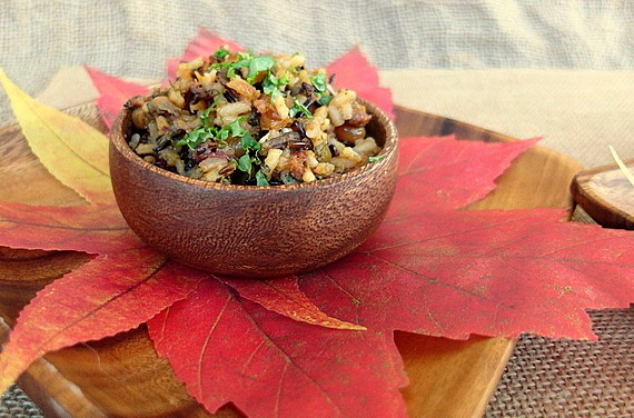 small bowl of white and wild rice stuffing on paper leaves