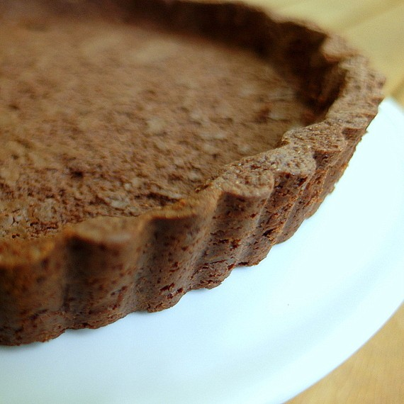 close up of baked, fluted chocolate sable tart dough