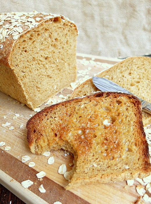 A toasted piece of oatmeal porter bread.