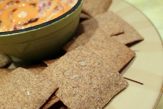 Caraway rye crackers with Reuben dip on a plate ready for serving.