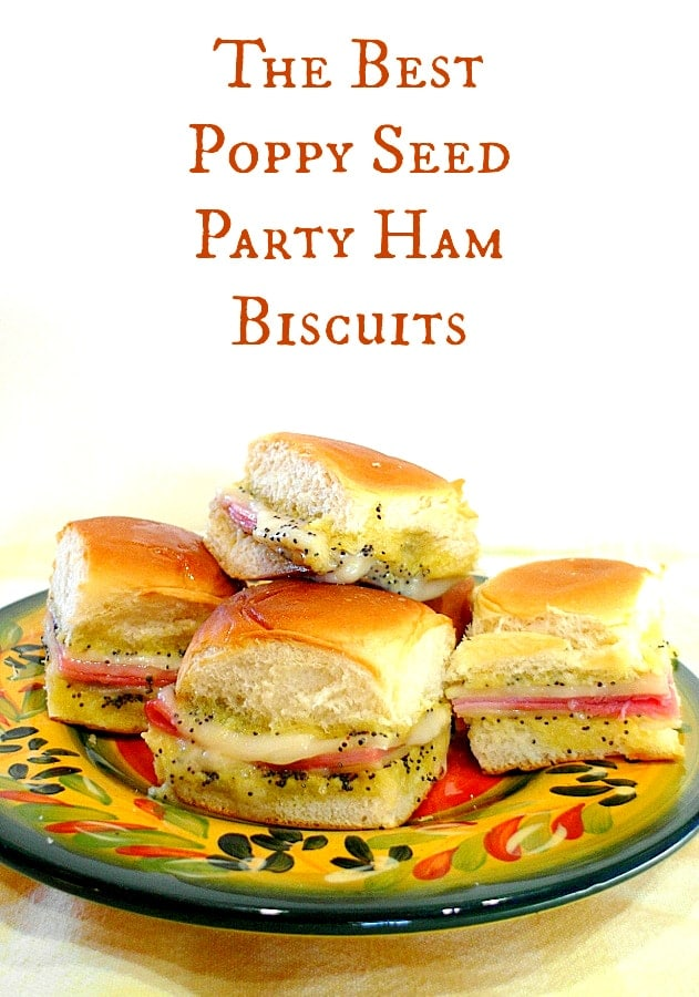 """A plate of ham and Swiss cheese sliders with poppy seeds on a plate. Text reads """"the best poppy seed party ham biscuits""""."""
