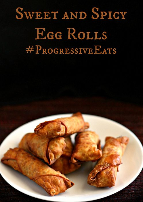Golden crispy sweet and spicy pork egg rolls on a white plate.