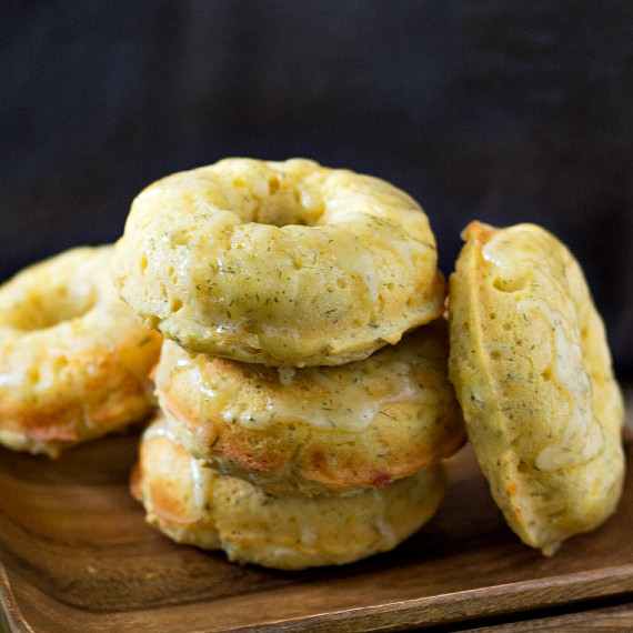 savory donuts on a wooden plate