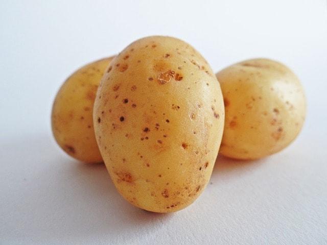 Three potatoes on a white background.
