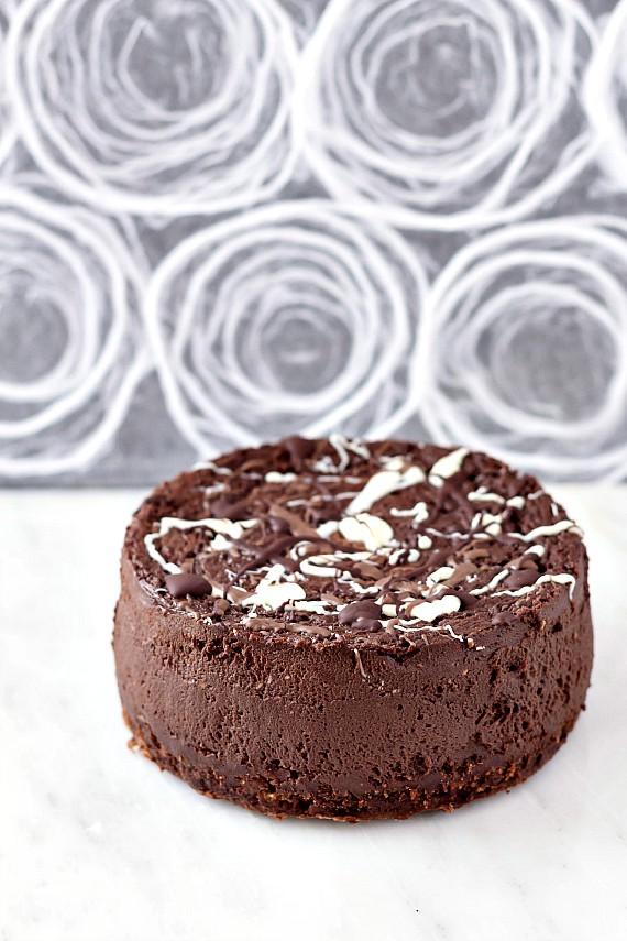 6 inch chocolate cheesecake splattered with dark, white, and milk chocolate