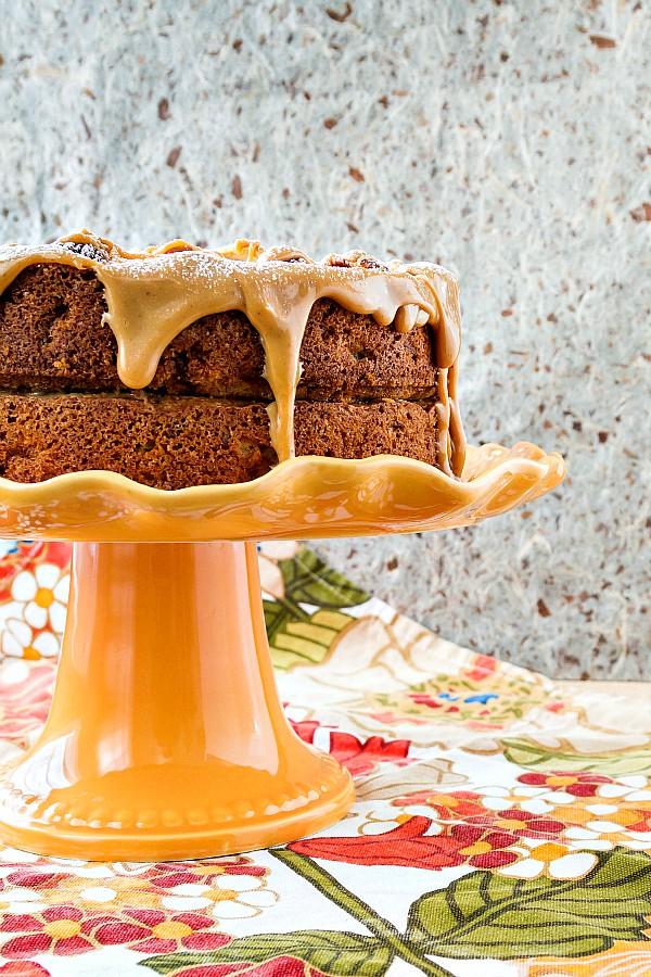 spiced apple cake on an orange cake stand