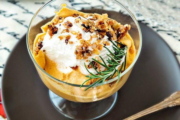 a dessert dish of pumpkin mousse with whipped cream