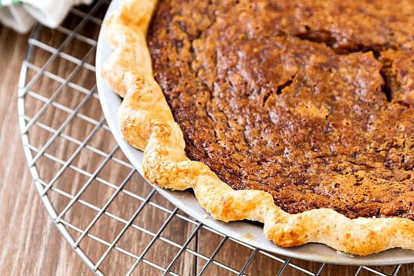 A close up of a custard pie on a cooling rack