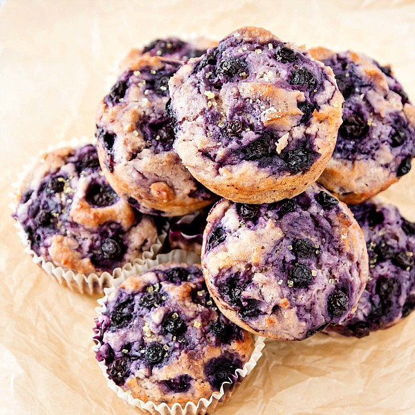 An overhead shot of a stack of dairy free blueberry muffins.