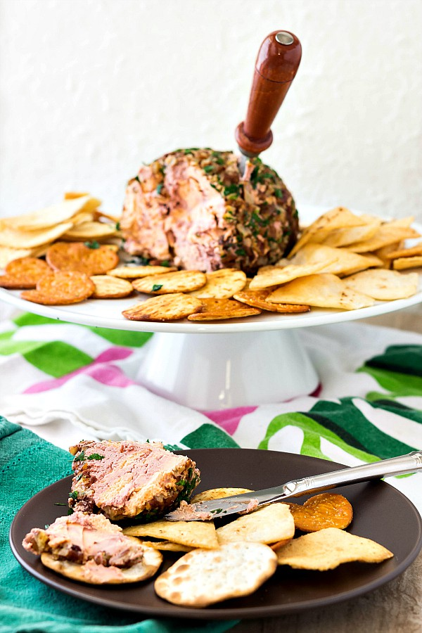 port wine cheese ball on a stand with crackers