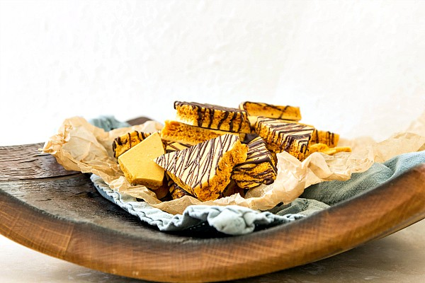 a plate of honeycomb candy drizzled with chocolate