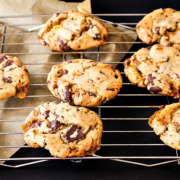 Chocolate chip bourbon honeycomb cookies on a cooling rack.