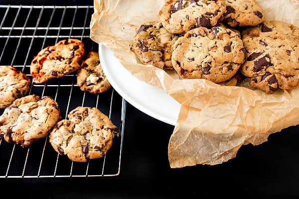 a cooling rack of honeycomb chocolate chunk cookies and a plate of cookies