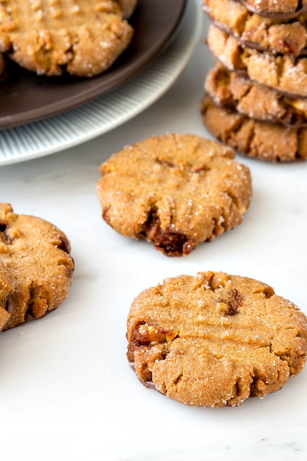Close up of triple peanut butter cookies with hints of chocolate spread on the bottoms.