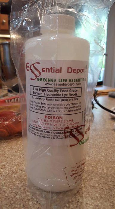A white plastic bottle of food grade lye.