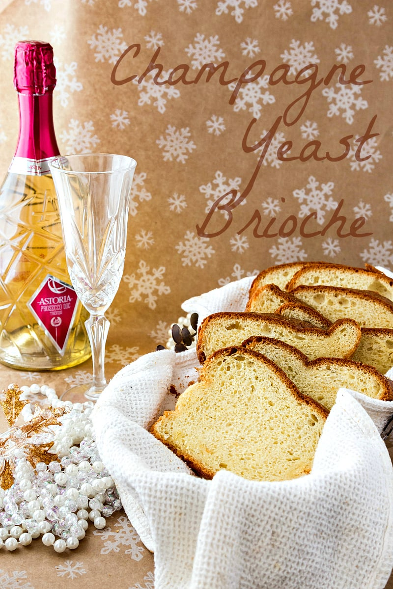 a basket with sliced champagne yeast brioche and a bottle of champagne in the background