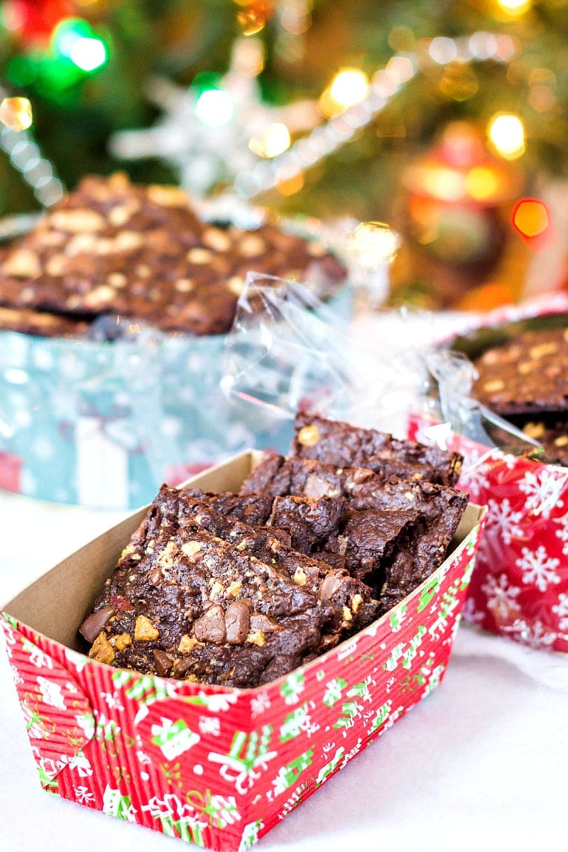 Christmas cardboard loaf pans filled with squares of crispy peppermint brownie brittle.