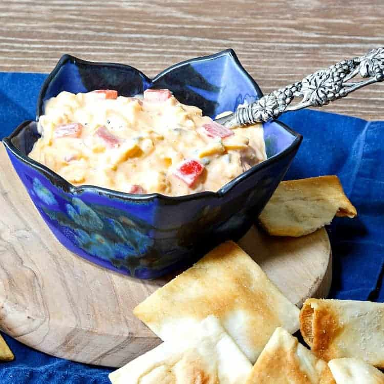 close up of a blue bowl of pimento cheese spread