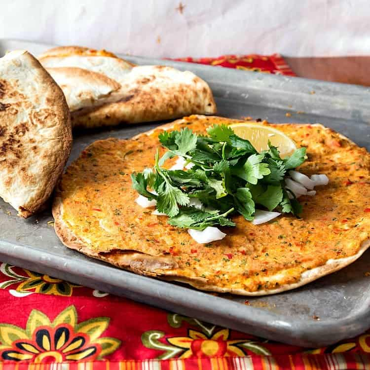 A sheet pan with vegan lahmajoun with cilantro and onions.