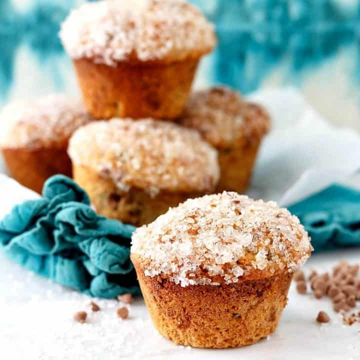 square image of muffins stacked on an aqua napkin