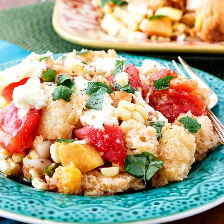 Summer Tomato Peach Panzanella makes good use of late summer produce. Enjoy the last of the juicy tomatoes and peaches, add some sweet corn, maybe some fresh peppers and cucumber, and don't forget the Vidalia onions! If you're a panzanella salad fan, you're going to love this later summer tomato peach version. | pastrychefonline.com