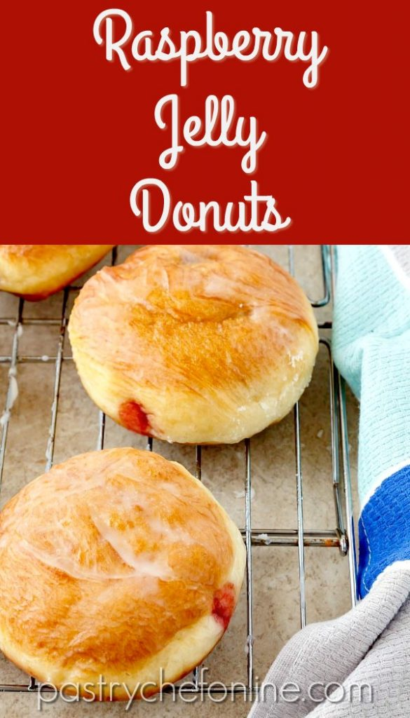 """image of glazed, filled doughnuts on a cooling rack. Text reads """"Raspberry Jelly Donuts"""""""