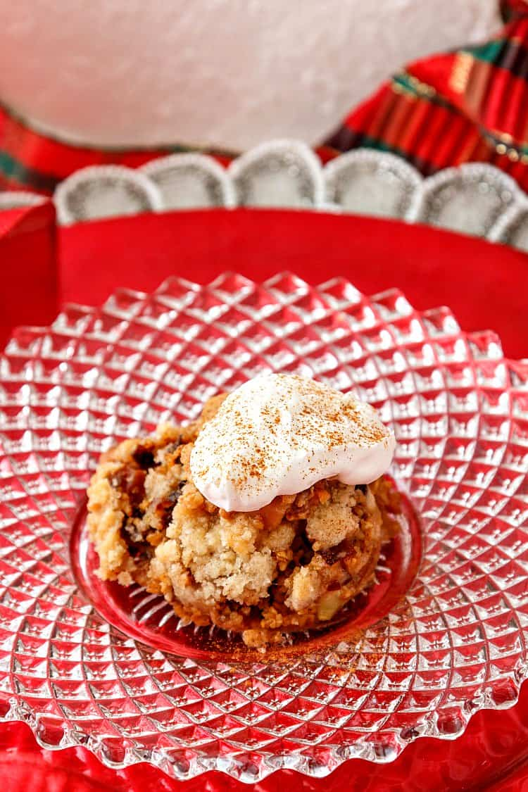 a glass plate on a red background with baked steel cut oats and whipped cream