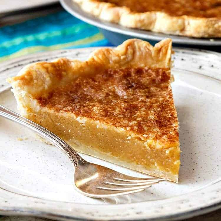 old fashioned pie recipes: a slice of vinegar pie on a beige plate