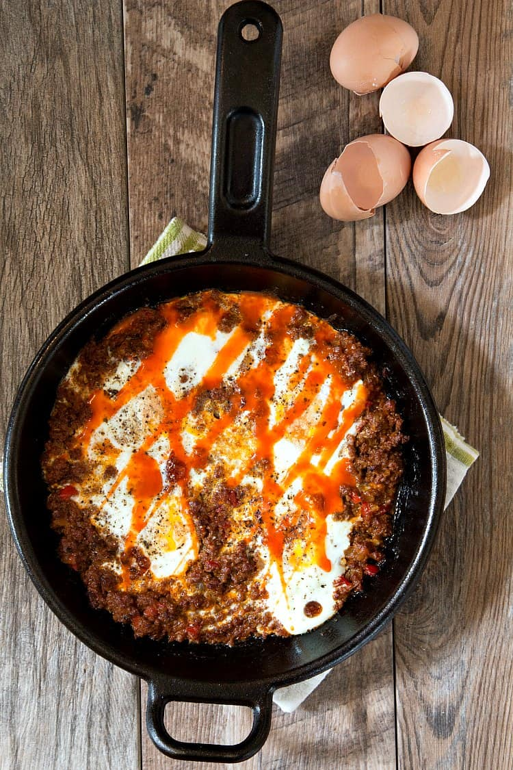 overhead shot of baked eggs and ground beef in a skillet