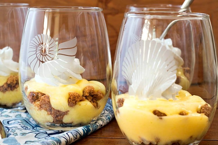 Four key lime pie parfaits in glasses.