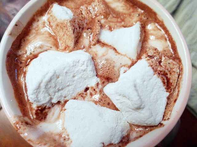 overhead shot of mug of hot chocolate with homemade marshmallows in it