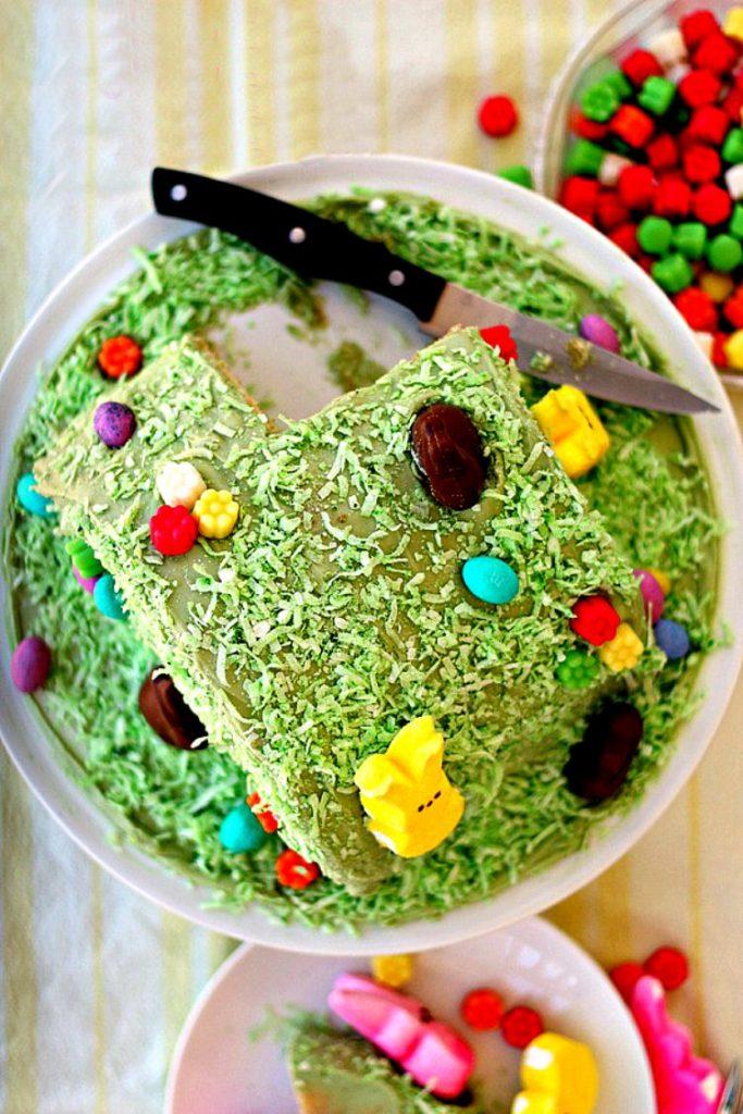 overhead shot of green easter bunny hill cake on platter