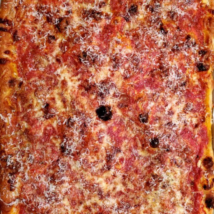 overhead shot of whole rectangular lasagna pizza