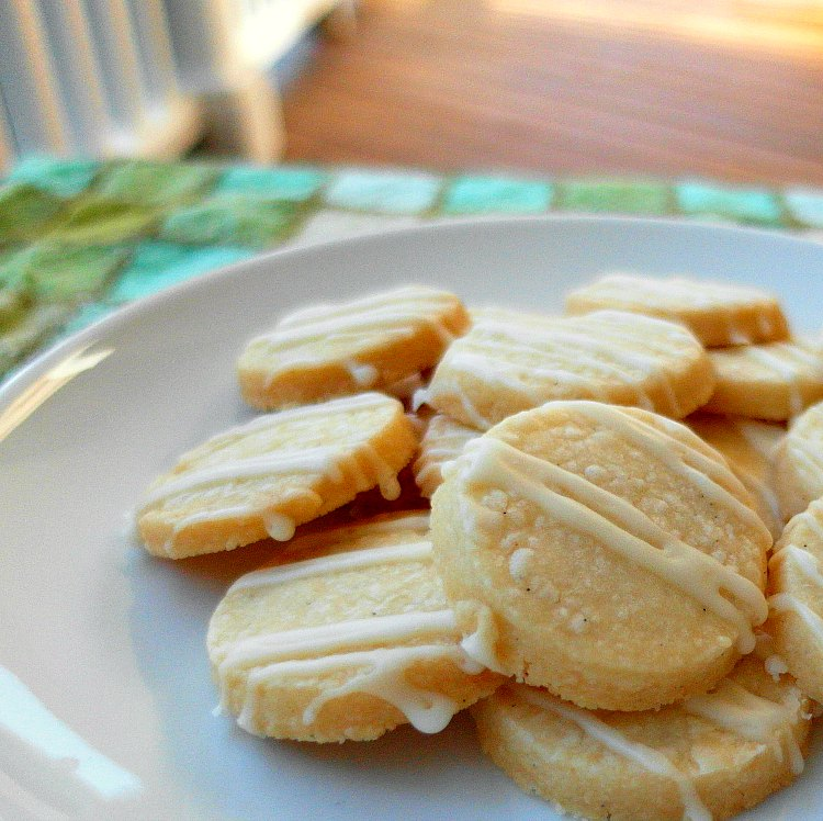 a white plate with small round cookies piled on it
