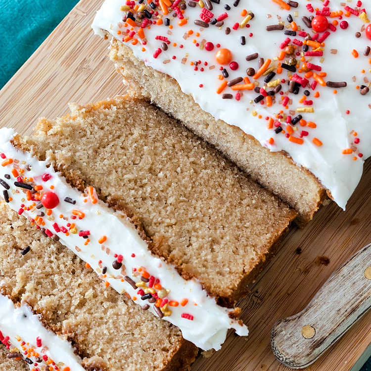 Slices of brown sugar cinnamon pound cake with thick white glaze and sprinkles.
