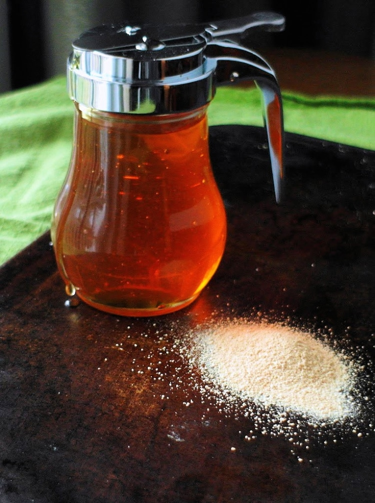 a Jar of honey and a pile of dry yeast