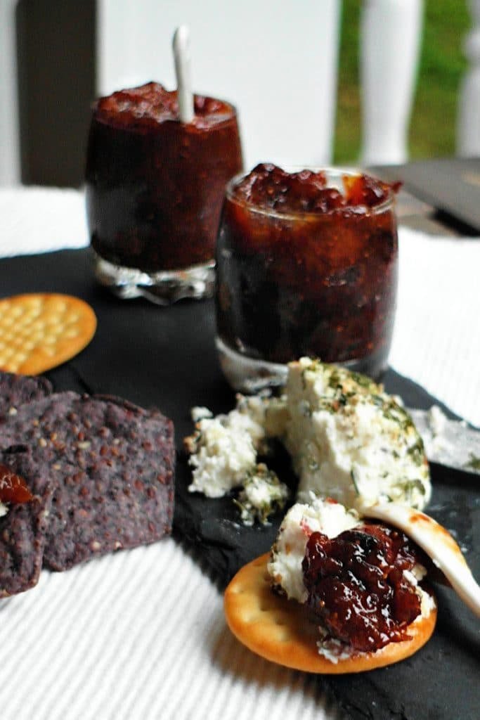 Fig jam with goat cheese on crackers.