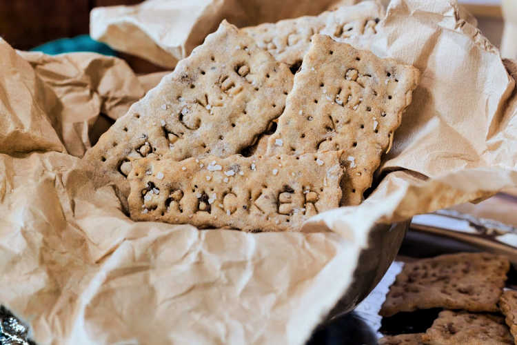 "close up of crackers with the word ""cracker"" pressed into them"