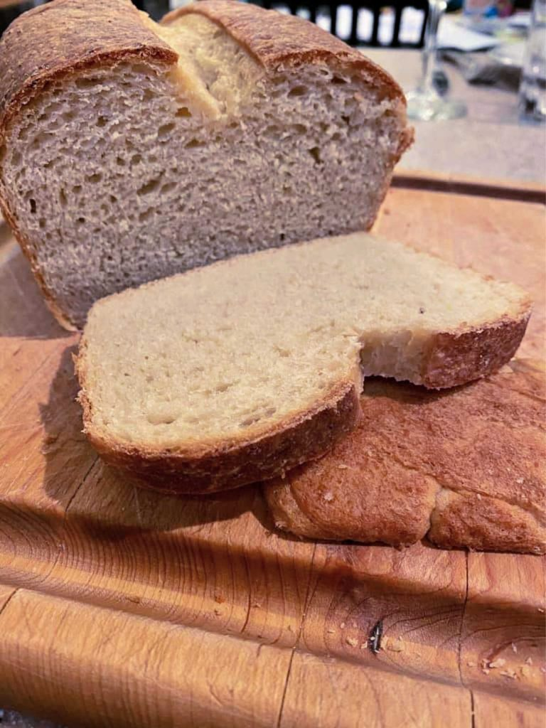 A loaf of bread, with one slice cut off.