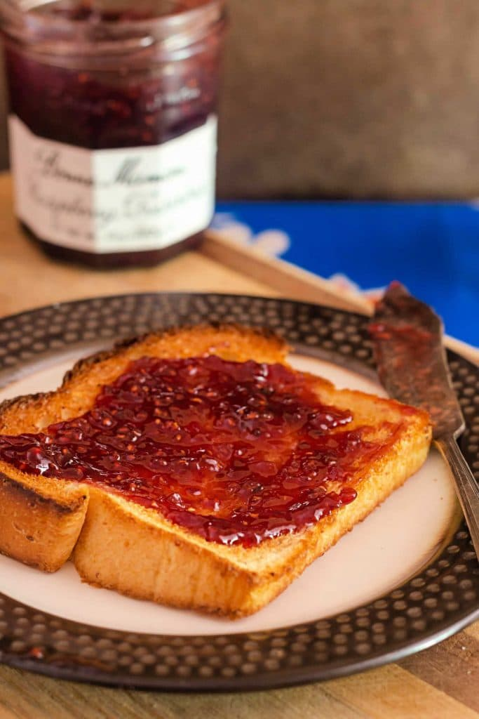 Toasted grits bread slice with raspberry jam